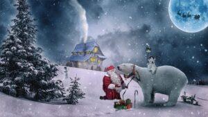 Ideje za poklon za Božić. Na slici snježna idila, kućica iz kuje se vidi svjetlost i dim i dimnjaka. Djed mraz sa polarnim medvjedom i poklonima.